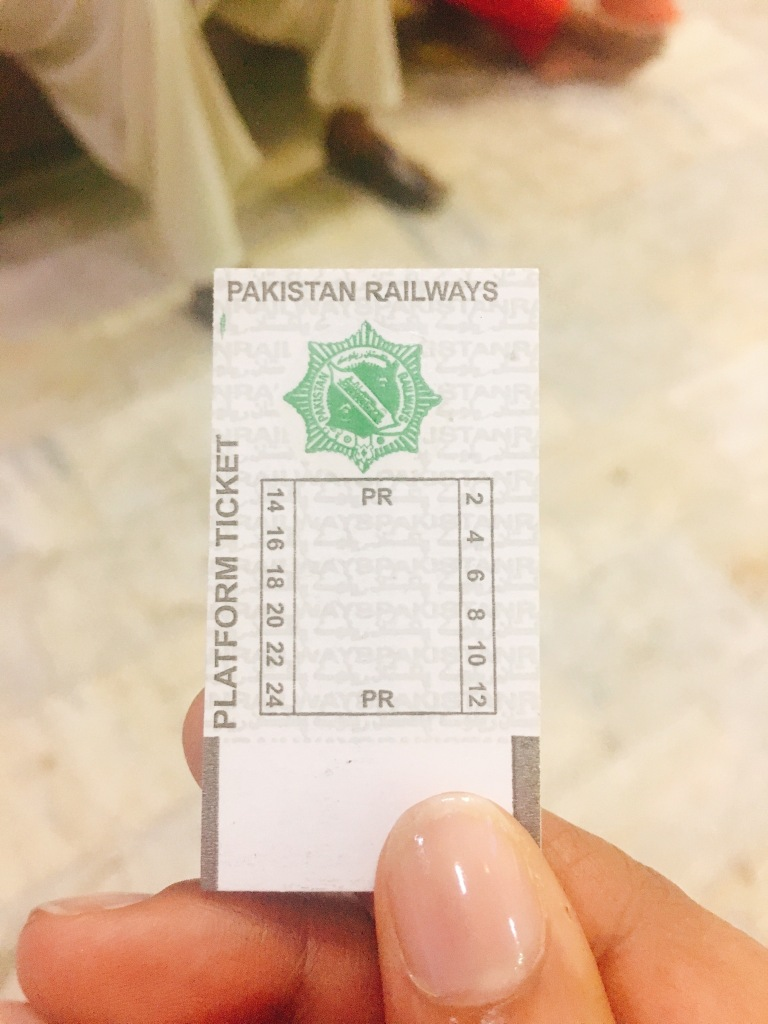 Holding a platform ticket at Pakistan Railways station in Lahore, Pakistan.