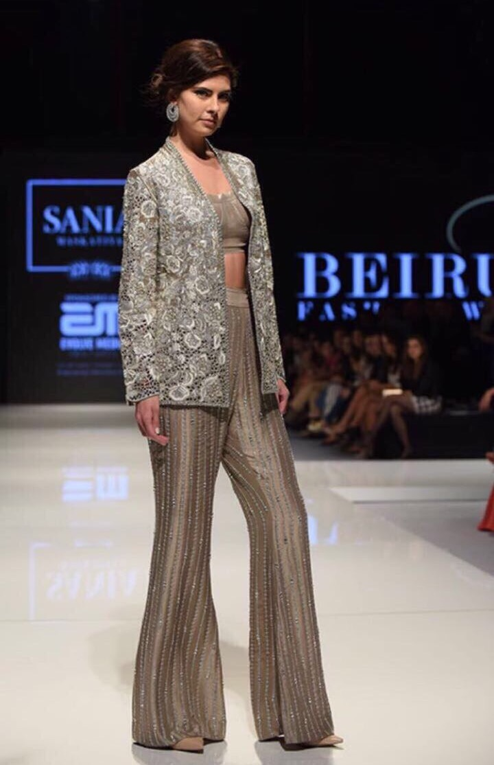 A model walks the runway in an outfit by Pakistani designer Sania Maskatiya at Beirut Fashion Week